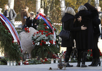 Mourners attend a memorial in Smolensk for the victims of the Polish Tupolev Tu-154 presidential aircraft crash