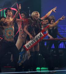 Singer Kesha performs with dancers at MTV Video Music Awards Japan 2010 in Tokyo