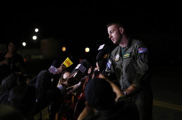 A Royal Australian Air Force P-3C Orion captain, Flight Lieutenant David O'Brien speaks to the press following his return to RAAF Base Pearce near Perth