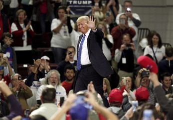 U.S. Republican presidential candidate Donald Trump enters a rally at the Florence Civic Center in Florence