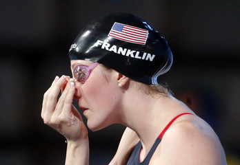 Franklin of the U.S. adjusts a clip in her nose before competing in the women's 200m backstroke semi-final during the World Swimming Championships at the Sant Jordi arena in Barcelona