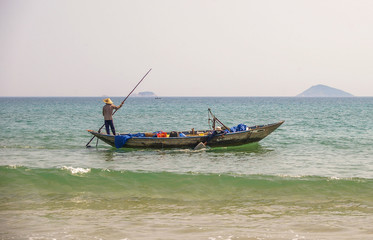 Traditional Vietnamese fishing along the beautiful coastline of Vietnam