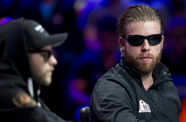 Jorryt Van Hoof of the Netherlands plays a hand against Felix Stephensen of Norway during the 2014 World Series of Poker main event final table at the Rio hotel-casino in Las Vegas