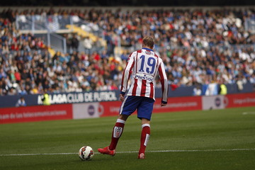 Atletico Madrid's Torres reacts after missing an opportunity to score against Malaga during their Spanish first division soccer match at La Rosaleda stadium in Malaga
