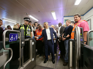 Mayor of London Sadiq Khan touches his Oyster card at an entry gate at Brixton Underground station, during the launch of London's Night Tube