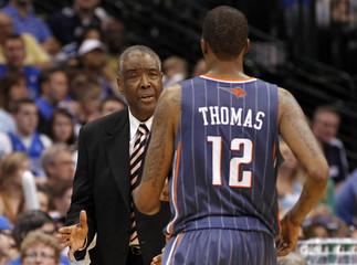 Bobcats head coach Silas talks with forward Thomas during their NBA basketball game in Dallas