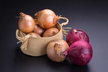 Fresh onion on black background.