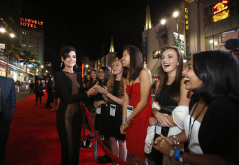 """Cast member Alexander greets fans at the premiere of """"Thor: The Dark World"""" at El Capitan theatre in Hollywood, California"""