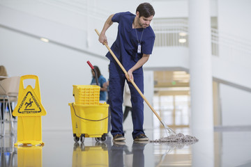 Male worker cleaning hospital floor Wall mural