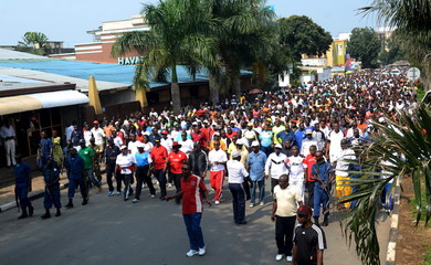 Residents march as they participate in a demonstration against the Rwandan government in Burundi's capital Bujumbura