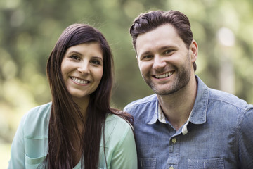 Close-up portrait of happy couple in park
