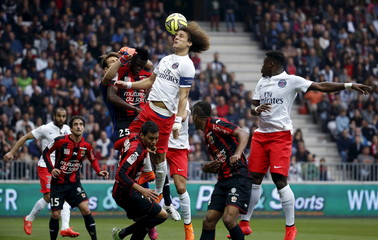 Paris St Germain's Luiz challenges Nice's defenders during their Ligue 1 soccer match at Allianz Riviera stadium in Nice