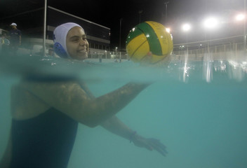 Milena Rodrigues de Oliveira smiles during her water polo trainning session at the Rocinha Sport Complex in Rio de Janeiro