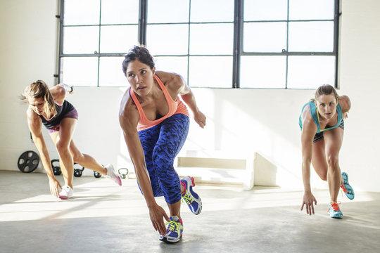 Female athletes exercising in gym
