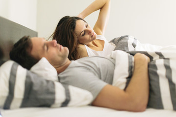 Couple in bed at home