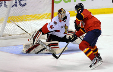 Ottawa Senators' Anderson blocks a shot by Florida Panthers' Skille during the third period of their NHL hockey game in Sunrise, Florida