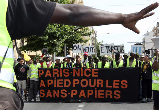 Illegal immigrants arrive from Paris to Nice, after a 30-day walk, to demand for legal working status