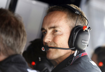 McLaren Formula One team principal Martin Whitmarsh monitors the race during the Chinese F1 Grand Prix at Shanghai International circuit