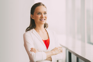 Pretty Smiling Business Woman Standing at Window