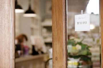 Open sign on glass door of store