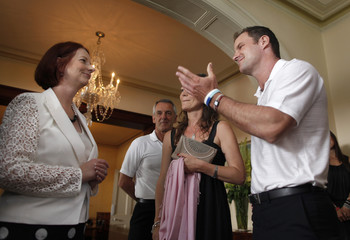 Strauss gestures to Australia's Prime Minister Gillard as she welcomes him to an afternoon tea for Ashes team members in Sydney