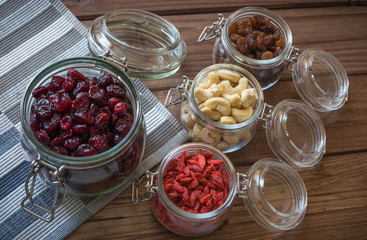 Healthy food / dried fruits, seeds and nuts on wooden table background.