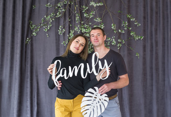 Portrait of loving couple together with curtains on background
