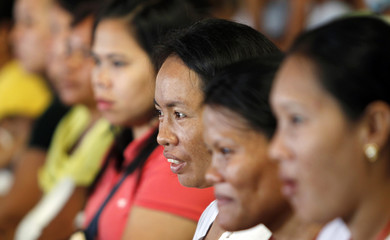 Filipino housewives listen during a family planning session in Manila's poor residential district of Baseco