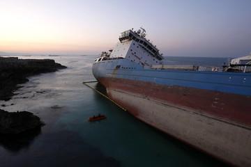 An empty Italian tanker runs aground on rocks off the Sicilian coast