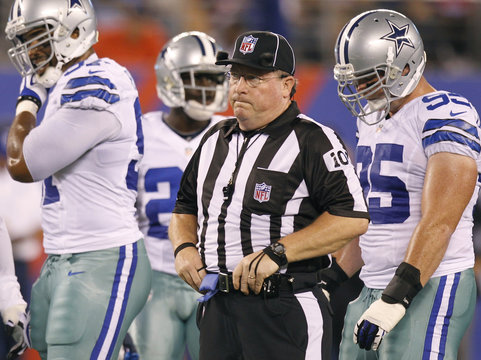 Replacement NFL Umpire Shoulders adjusts his belt as he works the season opening NFL football game between the Giants and the Cowboys in East Rutherford