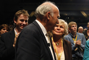 Britain's Business Secretary Vince Cable, stands with his wife Rachel after his speech at the Liberal Democrat party conference in Liverpool