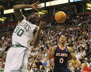 Boston Celtics Brandon Bass loses control of the ball in front of Atlanta Hawks Jeff Teague during the second half of Game 6 of their NBA Eastern Conference playoff basketball series in Boston