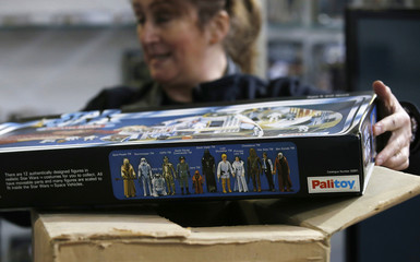 A worker unpacks a vintage Star Wars play ahead of an auction of Star Wars and film related toys at the Vectis auction house in Stockton-on-Tees