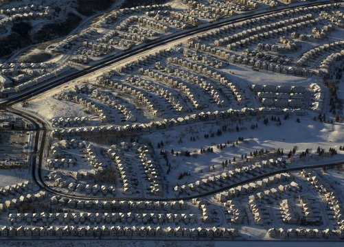 Residential homes are covered in fresh snow in this aerial view of Calgary