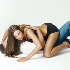 woman in sexy lingerie and man lying on floor