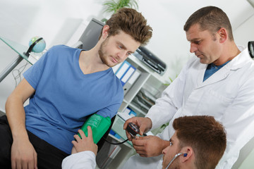 Young man having blood pressure tested