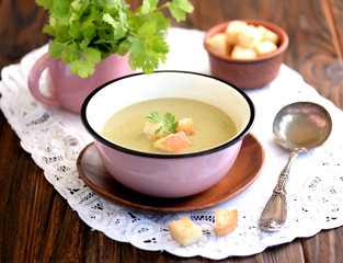Soup puree from zucchini with cream and crackers.
