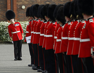 Irish Guards line up for an inspection at their barracks in Windsor, southern England
