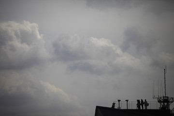 Visitors look to the north through a pair of binoculars at Imjingak pavilion near the demilitarized zone (DMZ) which separates the two Koreas, in Paju