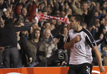 Clint Dempsey of Fulham celebrates after scoring the winning goal against Juventus during their Europa League last 16, second leg soccer match at Craven Cottage in London