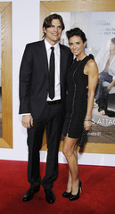 """Cast member Kutcher and his wife Moore pose at the premiere of """"No Strings Attached"""" at the Regency Village theatre in Los Angeles"""