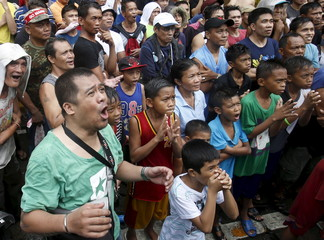Fans of local boxing icon Manny Pacquiao react after Floyd Mayweather Jr. was announced winner in the boxing bout at a public park in Marikina city