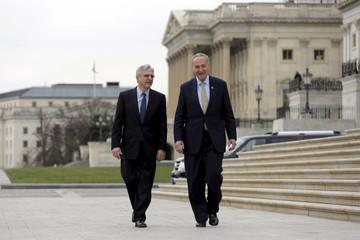Senator Charles Schumer (D-NY) walks with Judge Merrick Garland, President Obama's Supreme Court nominee, on Capitol Hill in Washington