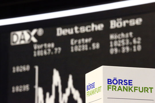 A box with the text 'Frankfurt stock exchange' stands in front of the German share price index DAX board