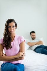 Couple ignoring each other in bedroom