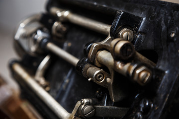 Old machinery close-up. Retro style mechanism, gear, metal cogwheels, nuts and bolts.