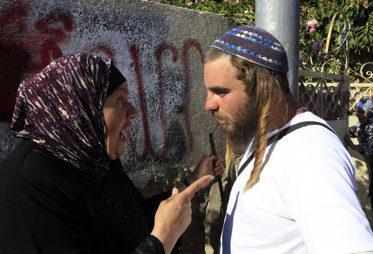 A Palestinian woman argues with an Israeli right-wing activist during a parade marking Jerusalem Day in East Jerusalem