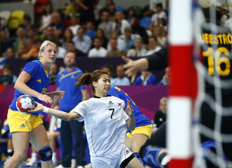 South Korea's Gwon Han-na takes a shot against Sweden's goalkeeper Cecilia Grubbstrom in their women's handball Preliminaries Group B match at the Copper Box venue during the London 2012 Olympic Games