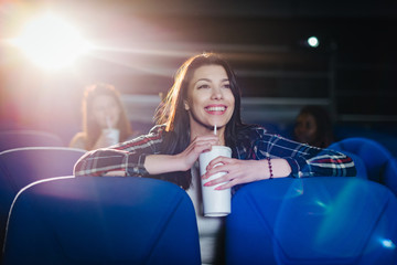 Gorgeous woman watching a comedy movie