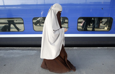 Kenza Drider, a French Muslim of North African descent, wearing a niqab, arrives at the Gare de Lyon railway station in Paris